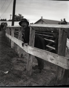 Thumbnail of Thomas Mack Feature picture, Hobo for the County Fair: image of Mack peeking through a fence