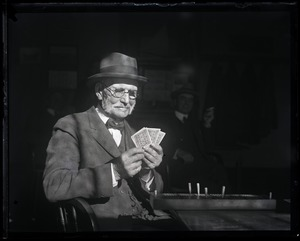 Thumbnail of Capt. Marchard Older man playing cribbage in a bar: 'deceased'
