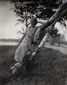 Thumbnail of Gertrude Kear (?) posed, leaning against a birch tree Views taken at the artists' colony founded on the former Vanderbilt estate,          Idle Hour (1926-1936).
