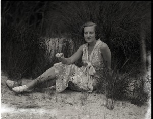 Thumbnail of Gertrude Kear (?) posed, seated on the ground Views taken at the artists' colony founded on the former Vanderbilt estate,          Idle Hour (1926-1936).