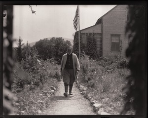 Thumbnail of Professor Will Monroe Walking down a garden path at his house at Camel's Hump