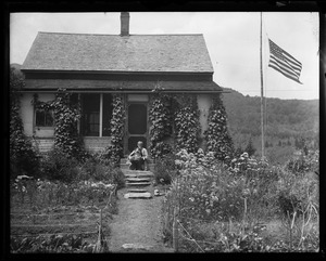 Thumbnail of Professor Will Monroe Seated on the steps of his house at Camel's Hump with his dog