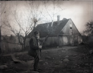 Thumbnail of Mr. Poole Elderly man with walking stick, standing near a barn