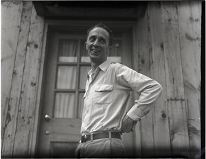 Thumbnail of Norman Rockwell standing outside the door to his studio At his studio in Arlington, Vermont, sometime before it burned down in 1943