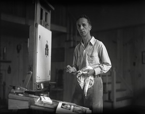 Thumbnail of Norman Rockwell standing at an easel, painting At his studio in Arlington, Vermont, sometime before it burned down in 1943