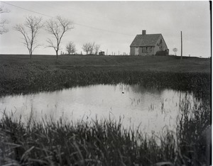 Thumbnail of Home and pond of Reuben Austin Snow, the cross-dressing hermit of Cape Cod