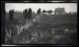 Thumbnail of Reuben Austin Snow, the cross-dressing hermit of Cape Cod View down a fence line of cottage and grounds