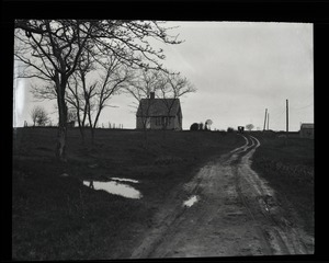 Thumbnail of Reuben Austin Snow, the cross-dressing hermit of Cape Cod View down the road of cottage and grounds