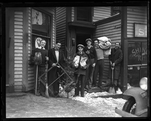 Thumbnail of H. B.  Six men, probably supporters of Swasey, with a newly-cut Christmas tree,          blankets, brooms
