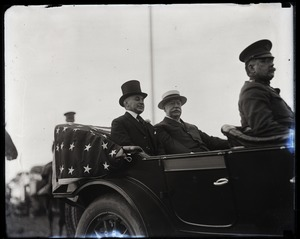 Thumbnail of William Howard Taft and Gov. Channing Harris Cox (l. to r.), riding in touring          car