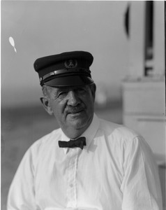 Thumbnail of Fred Tibbets Portrait wearing lighthouse service hat