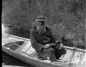Thumbnail of Benjamin 'Benny' Wells, Maine hermit Seated in a row boat