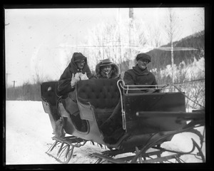 Thumbnail of Paul Whelton riding in a sleigh Blackington and Whelton (not in costume) in a sleigh driven by unidentified man