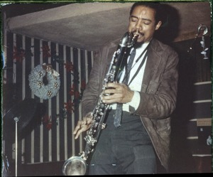 Thumbnail of Eric Dolphy: three-quarter length portrait performing on stage