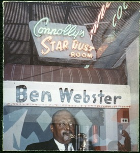 Thumbnail of Ben Webster: playing saxophone while reflected in the window of Connolly's Star       Dust Room