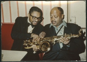 Thumbnail of Ben Webster (right) examining a saxophone with unidentified man at the Jazz       Workshop
