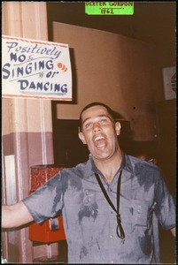 Thumbnail of Dexter Gordon: horsing around, singing underneath a sign reading 'Positively no       singing or dancing'