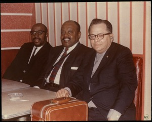 Thumbnail of Bernie Moss, Ben Webster, and Yusef Lateef (from right) seated in a       booth at the Jazz Workshop