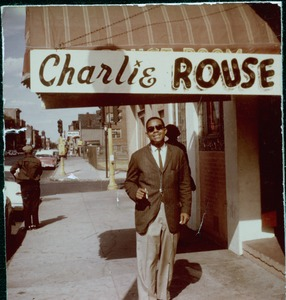 Thumbnail of Charlie Rouse, posed beneath his name on the marquee at Connolly's Stardust Room