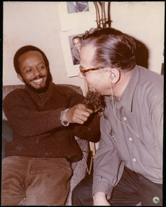 Thumbnail of Bernie Moss (right) wearing a false beard and joking around with an unidentified man