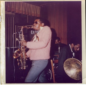 Thumbnail of Rahsaan Roland Kirk in pink sweater, performing with his band at the Jazz Workshop