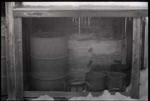 Thumbnail of Millers Falls: oil drum in a lean-to shed
