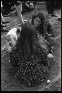 Thumbnail of Crowd on Cambridge Common: couple seated on the grass, with puppy