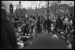Thumbnail of Crowd on Cambridge Common: J. Geils Band performing (J. Geils, guitar)