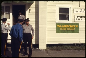 Thumbnail of Police standing outside fair office