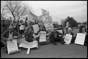 Thumbnail of Protests against U.S. intervention in Nicaragua at Westover Air Force             base: protesters seated on the pavement, including Frances Crowe (second from right)