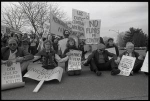 Thumbnail of Protests against U.S. intervention in Nicaragua at Westover Air Force             base: protesters seated on the pavement, including Frances Crowe (far right)