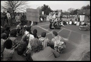 Thumbnail of Protests against U.S. intervention in Nicaragua at Westover Air Force             base: protesters seated on the pavement