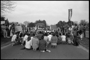 Thumbnail of Protests against U.S. intervention in Nicaragua at Westover Air Force             base: circle of protesters seated on the pavement