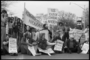 Thumbnail of Protests against U.S. intervention in Nicaragua at Westover Air Force             base: protesters with banners and signs opposing US intervention in Central             America
