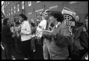 Thumbnail of Pro-choice protesters at Planned Parenthood clinic in Providence: demonstrators with 'Keep abortion legal' signs
