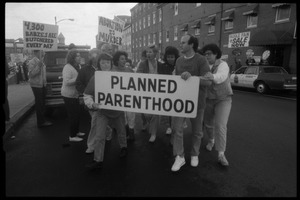 Thumbnail of Planned Parenthood escorts with banner passing pro-life protesters in front of the Providence Planned Parenthood clinic