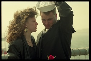 Thumbnail of Woman with a rose greeting a sailor from the USS Roberts returning from Persian             Gulf War duty