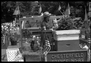 Thumbnail of Chesterfield Grange float with beehives, a calf, and ducks at Chesterfield's Fourth of July parade
