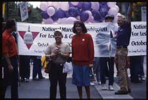 Thumbnail of Marchers in the San Francisco Pride Parade carrying a banner for National March         on Washington for Lesbian and Gary Rights