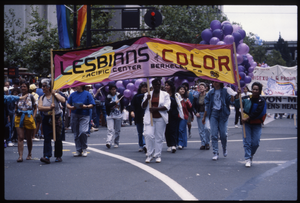 Marchers in the San Francisco Pride Parade carrying banner 'Lesbians of Color, Pacific Center, Berkeley'
