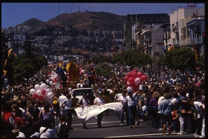Thumbnail of AIDS Emergency Fund marching in the San Francisco Pride Parade with float large             in the rear:  'Every Penny Counts'
