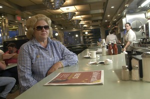 Thumbnail of Whately Diner: customer with dark glasses, seated at the counter