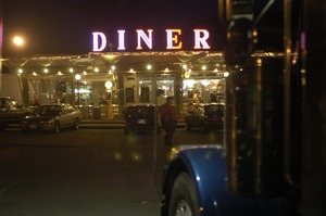 Thumbnail of Whately Diner: exterior of the diner, lit up at dusk