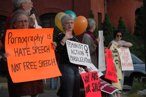 Thumbnail of Protest against a proposed pornographic video store in Northampton: protesters with signs reading 'Pornography is hate speech, not free speech',             'Feminist Action Mobilization'