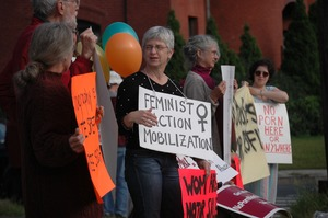 Thumbnail of Protest against a pornographic video store in Northampton: protesters with signs             reading 'Feminist Action Mobilization' and 'No porn here or anywhere'