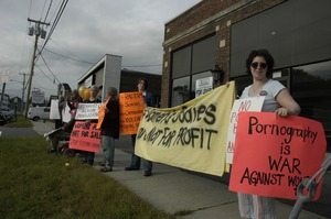 Thumbnail of Protest against a pornographic video store in Northampton: protesters in front             of proposed store site on King Street
