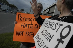 Thumbnail of Protest against a pornographic video store in Northampton: protesters holding             sign reading 'Pornography is hate speech, not free speech' and 'Feminist Action             Mobilization'