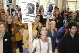 Thumbnail of UMass student strike: strikers in the entrance to the Student Union holding             signs supporting a general student strike