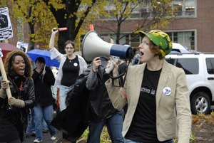 Thumbnail of UMass student strike: strike organizer with a bullhorn, leading the march outside the Student Union building