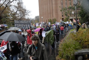 Thumbnail of UMass student strike: strikers marching past the Du Bois Library